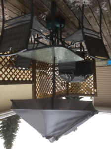 Glass topped Patio Table, 4 chairs and Umbrella