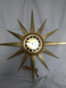 Horloge vintage; mid century; starburst; laiton; électrique