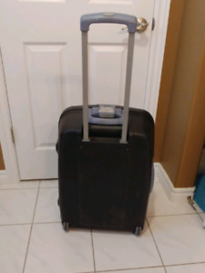 Delsey plastic suitcase with rollers.