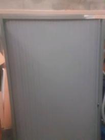 Tambour metal storage cabinet