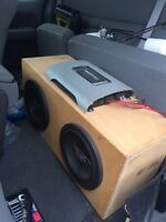 2 10 inch Rockford subs in box with amp