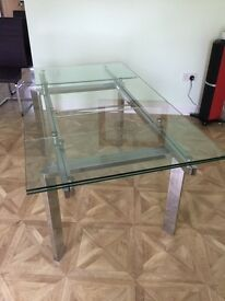 Modern Glass top table with chrome frame. seats 10 in very good condition.