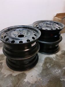 Black steel rims with used tires