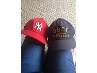 2 baseball caps. Yankees and obey.