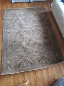 Beautiful 64 inch by 90 inch Brown rug