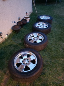"""Four Chevy 20"""" rims with Goodyear wrangler 275/60R20 tires"""