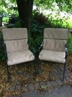 This is a pair of patio arm chairs with cushions