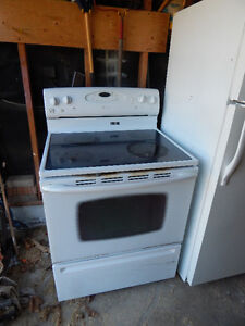 Maytag white stove, with black glass top