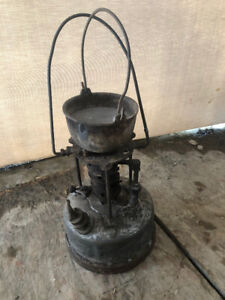 Goss inc. Antique lead smelter with pot