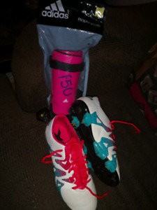 Girls adidas cleats and shin pads