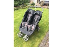Baby jogger city mini twin pushchair.