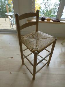 Antique ladder-back wicker chair