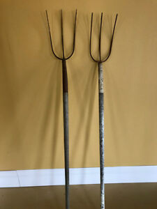 antique pitch forks -watering can
