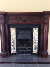 Victorian fireplace and solid wood surround.