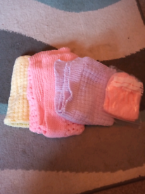 Selection Of Small Baby Blankets And Hats