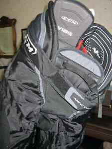 Hockey Gear and large 3 wheeled Bag (separate or  $140 all)