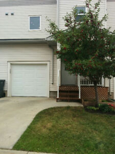 4 Bedroom 3.5 Bath with garage. Available August 1.