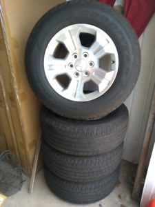 Chevy Silverado 18 inch aluminum rims and tires for $1400