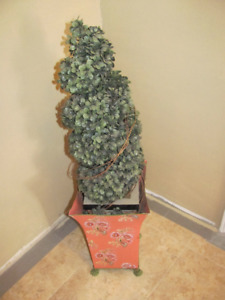 Decorative plastic tree shrub in metal pot