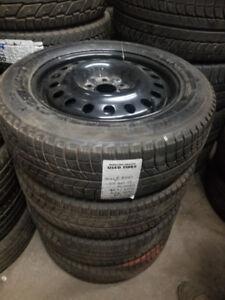 215 60 17 Michelin XIce 90% tread on Dodge Caliber rims 5x114.3