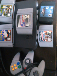 Nintendo 64 with controller and 5 games