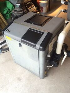 Jandy Above or in-ground pool heater and filter system.