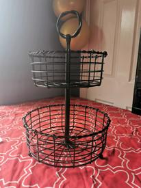 Nice Pretty black metal fruit basket.