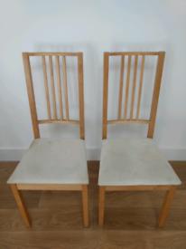2 Ikea Arin Ikea dining room matching chairs.