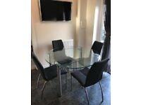 4 seater glass Dining Table & 2 seater sofa