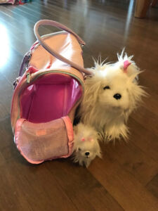 Toy puppy and baby in carrying case