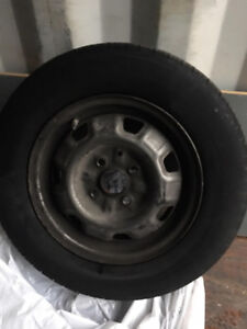 13 STEEL RIMS WITH USED TIRES TOYOTA