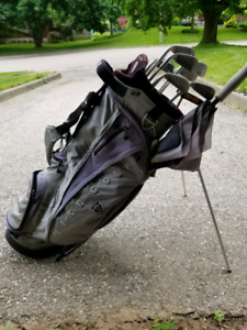 Men's right handed golf irons, putter and nike bag