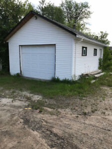 Vacant Lot for Sale with Garage!