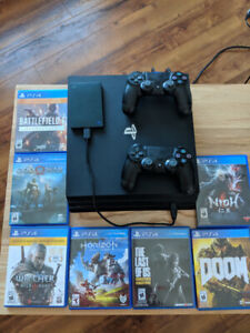 PS4 Pro w/ 2 controllers, 7 games and a plug and play hard drive
