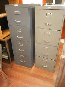 Four drawer legal size filing cabinets.