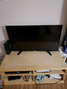 URGENT PICK UP.  NICE LIGHT COLORED WOODEN TV STAND.