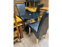 68. Table and 2 leather chairs