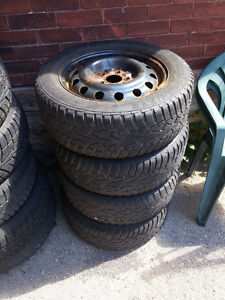 Set of 4 Like New Tires P205/60 R16 on 5 Bolt Rims