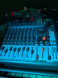 Behringer PMP1000 16 channel mixer with onboard effects.