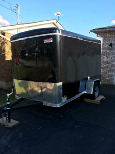 2018 Enclosed Trailer with drop down gate.