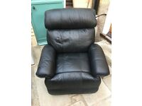 Black Leather recliner arm chair with some wear