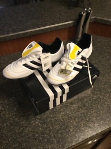 Brand new Adidas Puntero V size 12. Never worn and still in box.