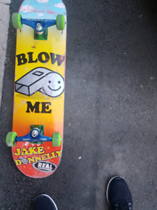 Skateboard with blow me caption