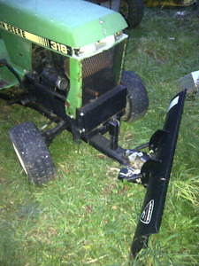 John Deere 312 Hydro with plow and tire chains and weight