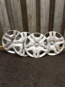 "Four 15"" Original Nissan Rim Covers"