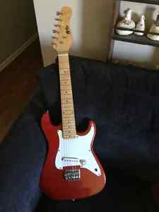 Peavy amp and Kids PowerPlay electric guitar
