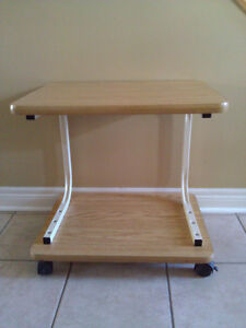 Wooden two tier end table stand on wheels