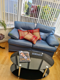 Two seater blue leather sofas