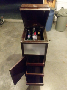 Vintage record player liquor cabinet
