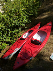 TWO KAYAKS WITH PADDLES AND LIFE JACKETS!